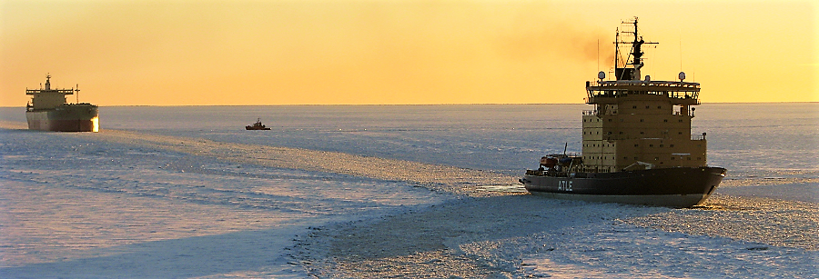 Icebreaker Atle assists a vessel.